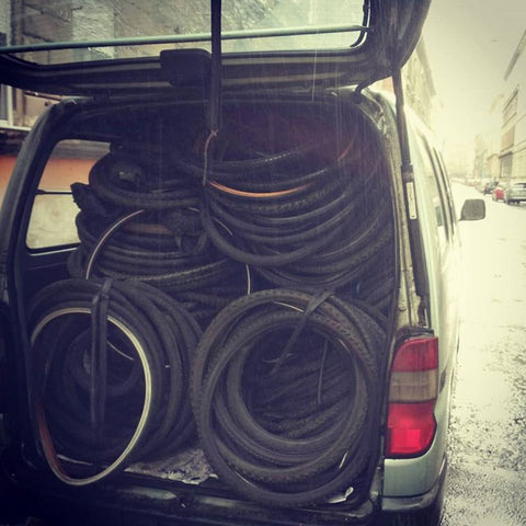 Taking the wornout bicycle tyres to the local recycling facility
