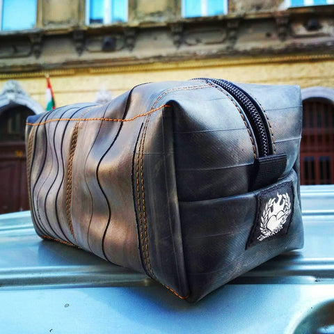 Orange toiletry bags made of upcycled bicycle tube are back in stock