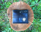 Black mens reclaimed biketube wallet in the wild
