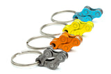 Black orange yellow blue bicycle keychains by Felvarrom