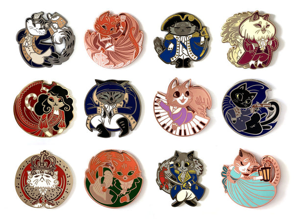 Enamel Pins depicted from left to right, top row: John Clawrens, Anjellicle Schuyler, George Pawshington, Thomas Jeffurson. Second row: Meowria Reynolds, Hercules Mewlligan, Philip Hameowlton, Aaron Purr. Third row: King George the Purred, Alexander Hameowlton, Meowquis de Lafayette, Felizabeth Schuyler.