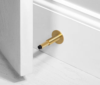 أداة إيقاف الأبواب DOOR STOP / WALL / BRASS زهبي door holder Buster and Punch