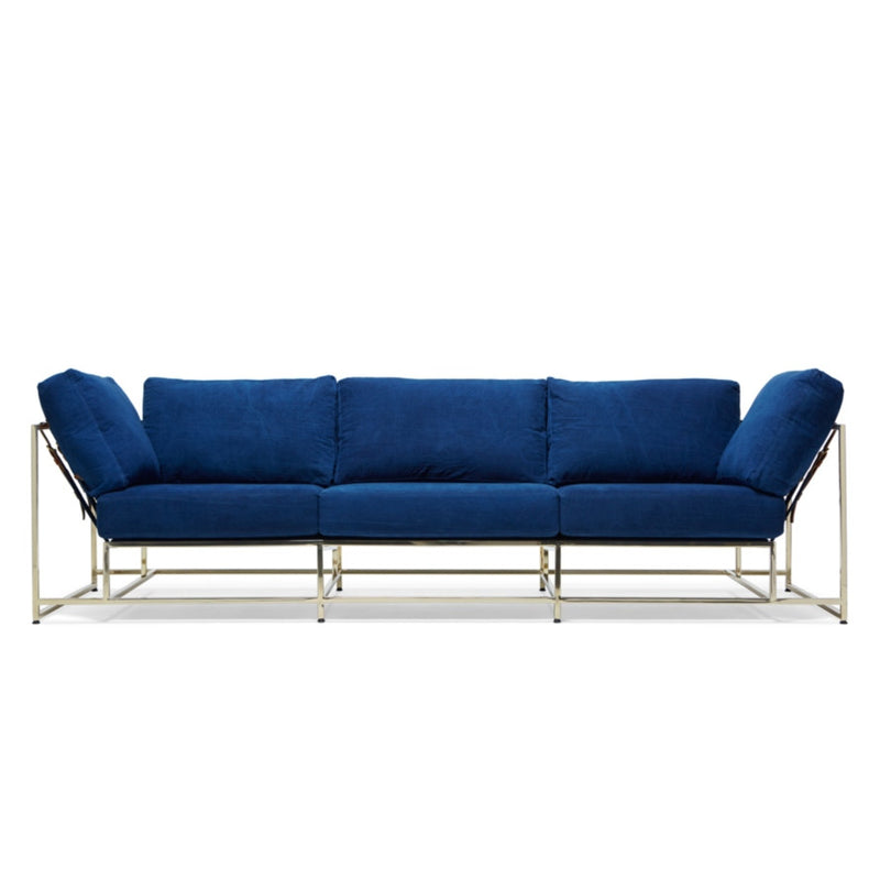 Utilizing the same hand-dipped, naturally dyed indigo canvas from the Stephen Kenn + Simon Miller collection, this sofa pairs it with a modern polished brass frame finish, indigo webbing, and cognac leather belts.
