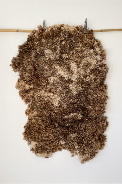 WOOLLEN RUG - HAND FELTED IN LIGHT BROWN