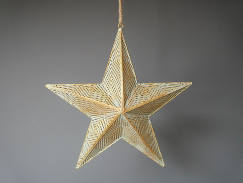 metal hanging star with filigree detailing on a rustic jute rope hanger