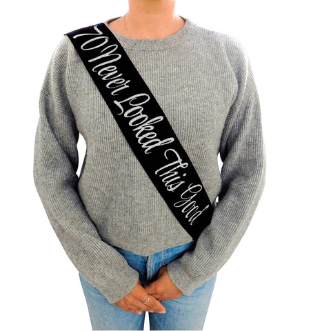 """70 Never Looked This Good"" Black Glitter Sash"