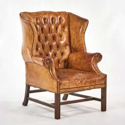 a leather tufted wingback chair sold
