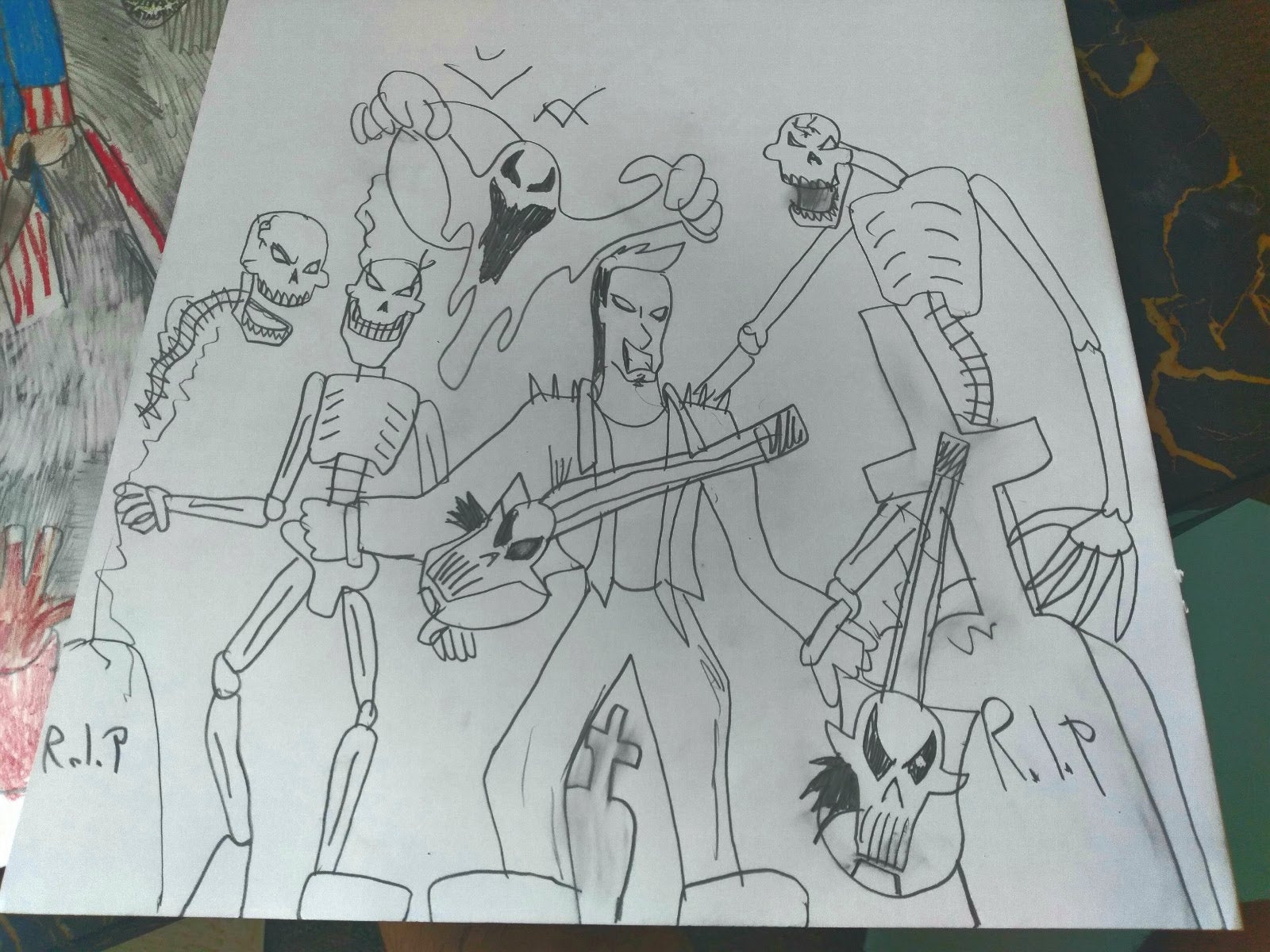 """a pencil drawing on white paper, photographed against a stack of other drawings. The image shows a figure holding a skull-and-bones shaped guitar standing in the center of the picture, surrounded by skeletons and ghosts and bats. There are several gravestones with """"RIP"""" written across their surfaces scattered around the ground. The characters all seem to be smiling and cackling with evil grins, and posed like members of a metal band."""