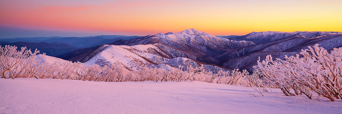 Sunrise from Mount Hotham looking to Mount Feathertop at sunrise with snow