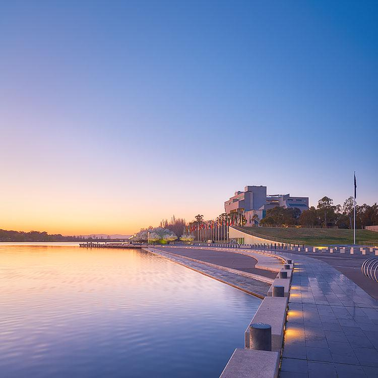 Canberra Awakes - Sunrise over Lake Burley Griffin and The High Court