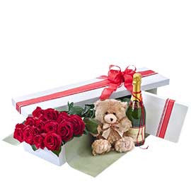 12 Long Stemmed Premium Colombian Red Roses in Presentation Box with Sparkling Wine, Chocolates & Teddy Bear