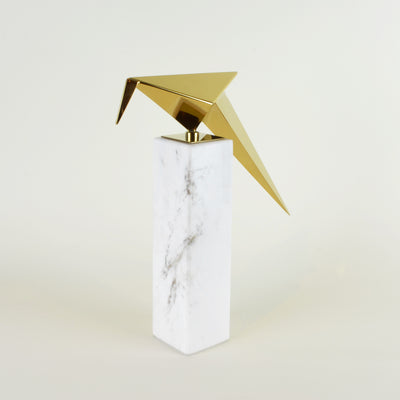 Leaning Origami Bird - View 1 - Contemporary Decorative Object. Inspired by the Japanese origami art. Gold colour ornament with Calacatta marble base. Origami Bird Sculpture. Materials: Nickel plated steel, Calacatta marble. Bird theme home accessories. M