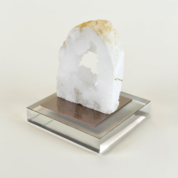 Geode Bookend - View 3 - Single Bookend. Rock crystal decorative object. Glass base with dark copper metal detail. Natural Geode slice. Each natural Geode slice is unique and differs in size and tones. Materials: Natural Geode, metal, glass. Dimensions: W12 D12 H14cm. Top interior design trend. Trendy designer gift for luxury homes. Natural stone ornament. Small size sculpture for styling coffee tables, shelves and console tables.