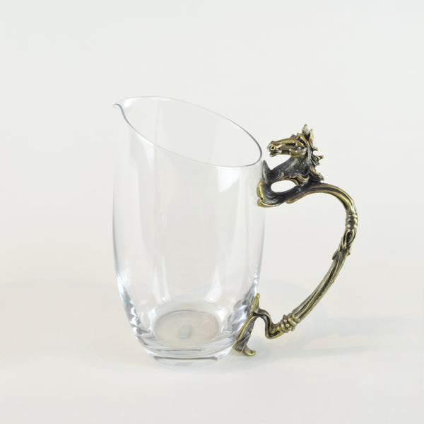 Horse Shot Glasses - Jug - Glassware set. Set includes 1x Jug and 6x Shot Glasses. Bronze colour. Bronze Horse Head and handle detail. Horse theme home accessories. Materials: High Grade Glass, Cast Bronze Handmade.  Shot Glass dimensions: Ø4 H7cm. Jug Carafe dimensions: W11 D7.5 H15cm. Dinner Party and home entertainment accessories. A designer gift to add to luxury homes. Royal Ascot theme home decor. Jug and shot glasses suitable for coffee and ginger shots.