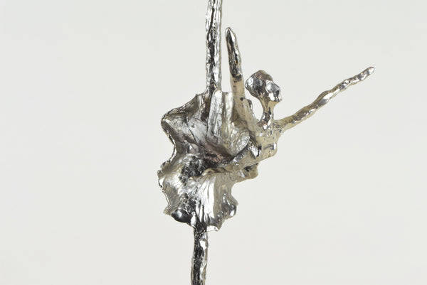 Black Swan Ballerina Sculpture - Detail - Decorative Object / Sculpture. Silver / Pewter Colour. Abstract Figurine Sculpture. Materials: Nickel, Clear Acrylic. Dimensions: W13 D6.5 H42cm. Ballet & Dance theme home accessories. Feminine home decoration. Small - Medium size Sculpture / Ornament for styling shelves, niches and display units.