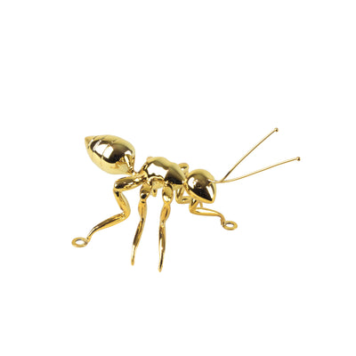 Gold Ant - View 1 - Best seller. Decorative Object / Sculpture. Gold Colour. Ant Decorative object. Can be used as a free standing ornament or wall decor. The Ant feet contains fixtures that allowed the sculpture to be hung on the wall and used as a sculp