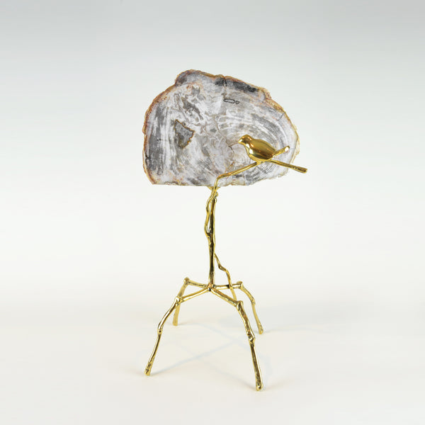 Petrified Bird Sculpture - View 2 - Brass Sculpture / Decorative Object. Bird sculptural detail. Gold, grey and taupe colours. Petrified Wood slice. Materials: Brass, Petrified Wood. Dimensions: W27(OA) D20 H50cm. Bird and nature theme home accessories. Animal Ornament. Designer gift. large size sculpture for styling shelves, display units, niches and console tables.