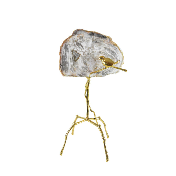 Petrified Bird Sculpture - View 1 - Brass Sculpture / Decorative Object. Bird sculptural detail. Gold, grey and taupe colours. Petrified Wood slice. Materials: Brass, Petrified Wood. Dimensions: W27(OA) D20 H50cm. Bird and nature theme home accessories. Animal Ornament. Designer gift. large size sculpture for styling shelves, display units, niches and console tables.