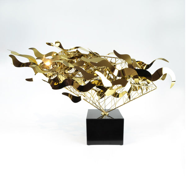 Bullet Sculpture - Gold View 2 - Metal Sculpture. Abstract style large decorative object. Complex handmade sculpture. Mirror polished metal. Black marble base. Metal available in two colours: Gold and Silver.  Materials: Plated steel, marble. Dimensions: W98 D25 H58cm. Centrepiece home decor. A luxurious sculpture to be the focal point in any interior. Ideal gift for valentine's day. Large - XL size Sculpture / Ornament for styling sideboards, console tables and display units.