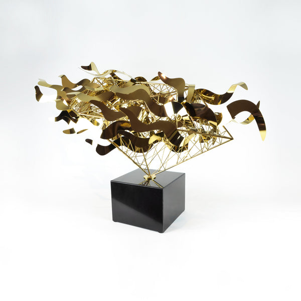 Bullet Sculpture - Gold View 3 - Metal Sculpture. Abstract style large decorative object. Complex handmade sculpture. Mirror polished metal. Black marble base. Metal available in two colours: Gold and Silver.  Materials: Plated steel, marble. Dimensions: W98 D25 H58cm. Centrepiece home decor. A luxurious sculpture to be the focal point in any interior. Ideal gift for valentine's day. Large - XL size Sculpture / Ornament for styling sideboards, console tables and display units.