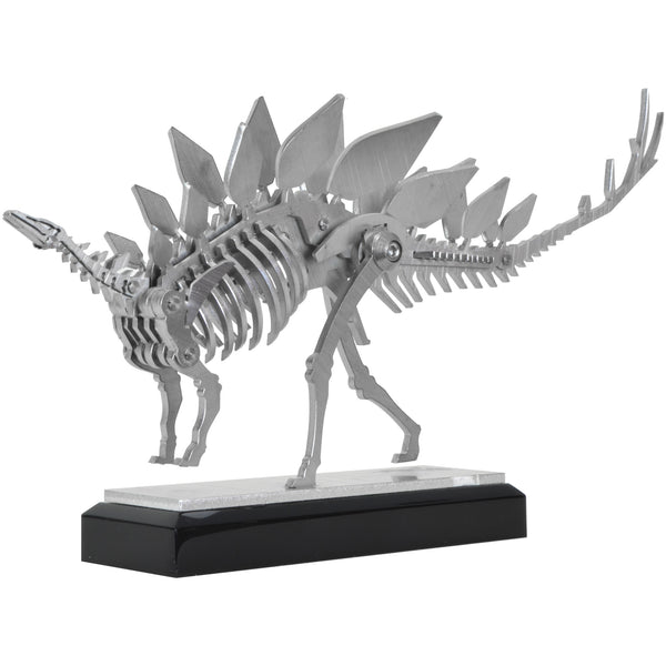 Mini Stegosaurus - View 1 - Decorative Object / Sculpture. Silver Colour. Dinosaur Sculpture. Stegosaurus skeleton ornament. Industrial chic style dinosaur object. Materials: Brushed Stainless steel. Acrylic base. Jurassic Park theme home accessories. Kids home decor. Dinosaur sculpture can be used to style coffee table books. Ideal gift for Jurassic World fans. Dimensions: W23 D4 H13cm. Small – Medium size Sculpture / Ornament for styling shelves, coffee tables and display units.