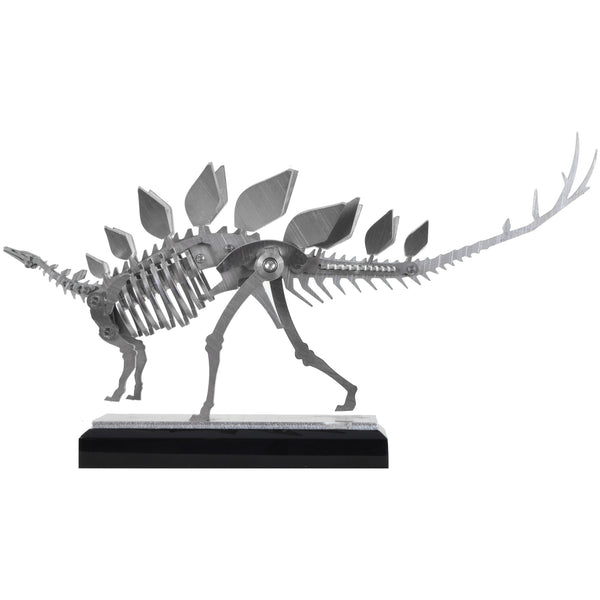 Mini Stegosaurus - View 2 - Decorative Object / Sculpture. Silver Colour. Dinosaur Sculpture. Stegosaurus skeleton ornament. Industrial chic style dinosaur object. Materials: Brushed Stainless steel. Acrylic base. Jurassic Park theme home accessories. Kids home decor. Dinosaur sculpture can be used to style coffee table books. Ideal gift for Jurassic World fans. Dimensions: W23 D4 H13cm. Small – Medium size Sculpture / Ornament for styling shelves, coffee tables and display units.