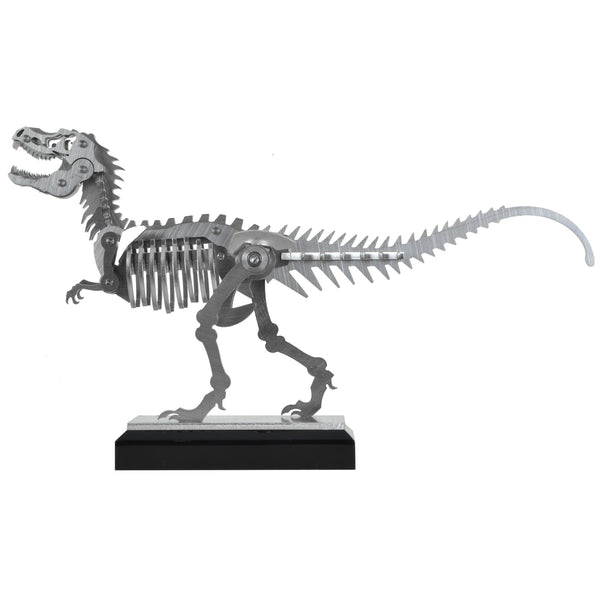 Mini T-Rex - View 2 - Decorative Object / Sculpture. Silver Colour. Dinosaur Sculpture. T-Rex skeleton ornament. Industrial chic style dinosaur object. Materials: Brushed Stainless steel. Acrylic base. Jurassic Park theme home accessories. Kids home decor. Dinosaur sculpture can be used to style coffee table books. Ideal gift for Jurassic World fans. Dimensions: W23 D4 H13cm. Small – Medium size Sculpture / Ornament for styling shelves, coffee tables and display units.