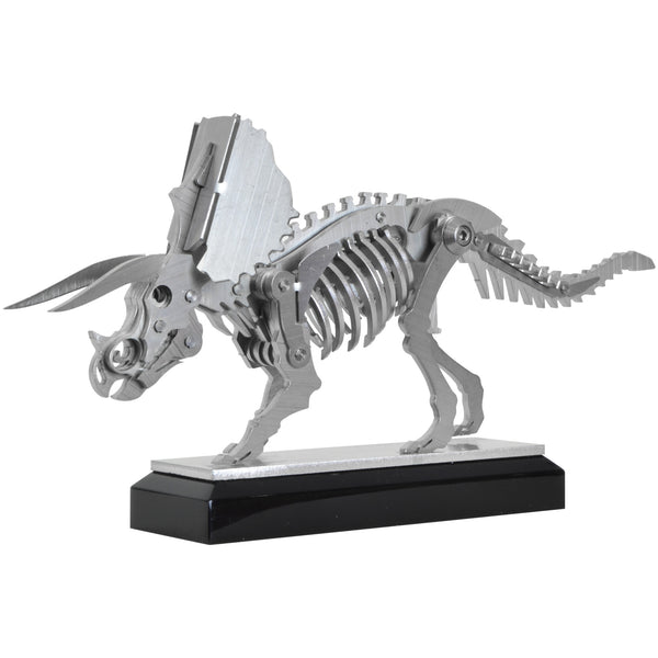 Mini Triceratops - View 1 - Decorative Object / Sculpture. Silver Colour. Dinosaur Sculpture. Triceratops skeleton ornament. Industrial chic style dinosaur object. Materials: Brushed Stainless steel. Acrylic base. Jurassic Park theme home accessories. Kids home decor. Dinosaur sculpture can be used to style coffee table books. Ideal gift for Jurassic World fans. Dimensions: W20 D4 H11cm. Small – Medium size Sculpture / Ornament for styling shelves, coffee tables and display units.