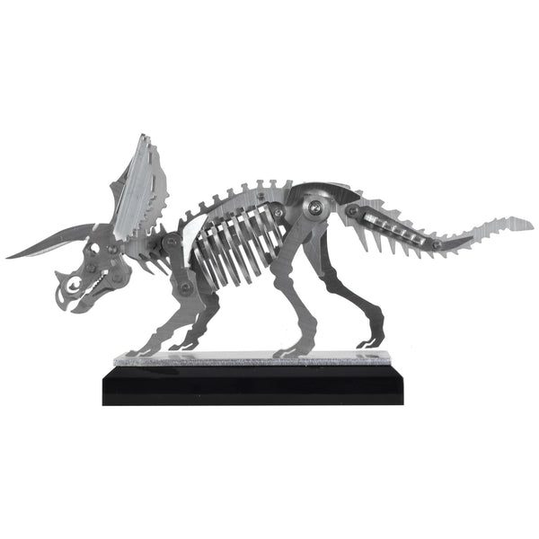 Mini Triceratops - View 2 - Decorative Object / Sculpture. Silver Colour. Dinosaur Sculpture. Triceratops skeleton ornament. Industrial chic style dinosaur object. Materials: Brushed Stainless steel. Acrylic base. Jurassic Park theme home accessories. Kids home decor. Dinosaur sculpture can be used to style coffee table books. Ideal gift for Jurassic World fans. Dimensions: W20 D4 H11cm. Small – Medium size Sculpture / Ornament for styling shelves, coffee tables and display units.