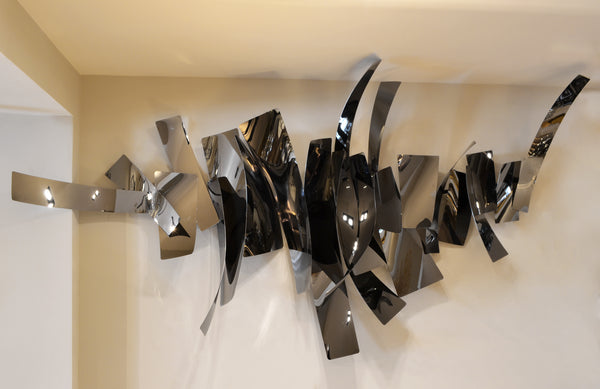 Black Flame - 3D Sculptural Wall Art. Statement Wall Decoration. Black metallic Colour. Polished black mirror finish. Materials: Black Chrome plated Steel. Dimensions (Approx. varies per unit): W200 H60-100cm Extrude 30-40cm. Top interior design trend. Large - giant size wall art that will be the focal point in Living Rooms, Dining Rooms, Staircases and Entrance Hallways.  The modern abstract metal wall sculpture is ideal for commercial design use in restaurants and office lobbies.
