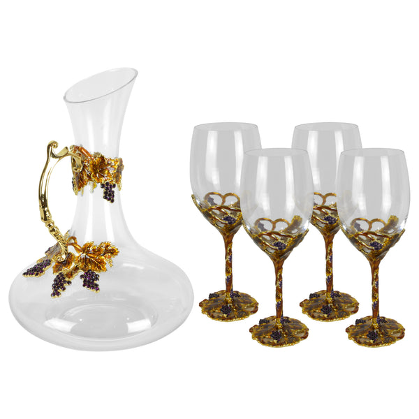Amber Wine Set - Glassware set. Set includes 1x Carafe and 4x Wine Glasses. Gold and Amber colour. Intricate metal and natural stone vine leaves detail. Natural Amber material and Swarovski coloured crystals.  Materials: High Grade Glass, Brass, Amber, Lacquer. Handmade.  Wine Glass dimensions: Ø7 H21cm. Glass Carafe dimensions: Ø20 H26cm. Dinner Party and home entertainment accessories. A designer gift to add to luxury homes.