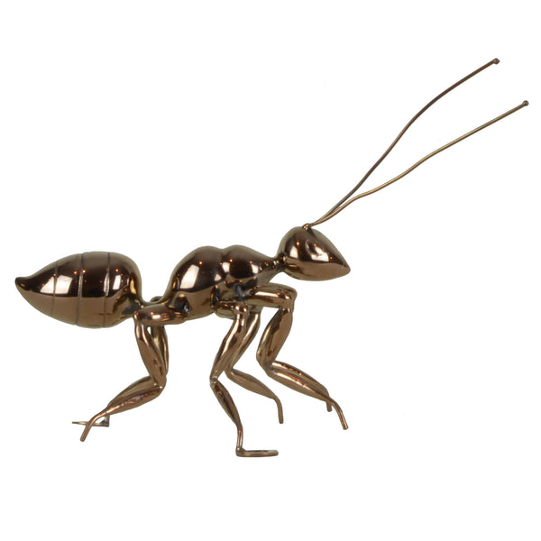 Copper Ant - View 1 - Best seller. Decorative Object / Sculpture. Copper Colour. Ant Decorative object. Can be used as a free standing ornament or wall decor. The Ant feet contains fixtures that allowed the sculpture to be hung on the wall and used as a sculptural wall art. Materials: Copper plated steel. Dimensions: W16 D7.5 H8cm. Insect theme home accessories. Use several ants to create a wall art installation. Use single ant ornament to style coffee table books. Top Interior design trend.