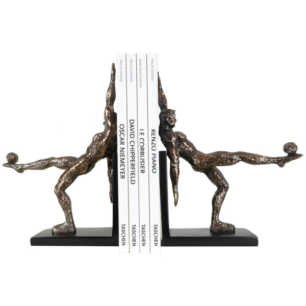 Footballer Bookends - View 2 - A pair of bookends. Bronze and Black colours. Football player sculpture on each bookend. Footballer figurine is made from copper plated resin. Materials: Copper plated resin. Dimensions: W20 D6 H26cm (Each). Football theme home accessories. A designer gift for football and fitness fans. Felt padding on the base to protect surfaces. Designer bookends for styling shelves and display units.