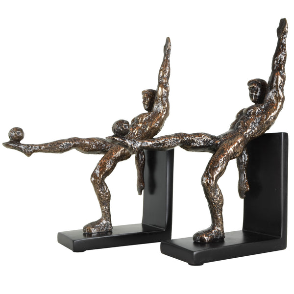 Footballer Bookends - View 1 - A pair of bookends. Bronze and Black colours. Football player sculpture on each bookend. Footballer figurine is made from copper plated resin. Materials: Copper plated resin. Dimensions: W20 D6 H26cm (Each). Football theme home accessories. A designer gift for football and fitness fans. Felt padding on the base to protect surfaces. Designer bookends for styling shelves and display units.