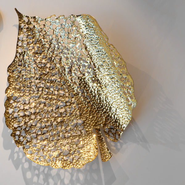 Gold Leaf - Shape A - 3D Sculptural Wall Art. Leaf shape wall sculpture. Statement Wall Decoration. Polished Gold Colour. Hammered finish. Materials: Nickel plated Steel. Available in 2 shapes/designs. Top interior design trend. Nature theme home accessories. Multiple Gold Leaves can be installed together to create a striking wall art installation. Large size wall art that will be the focal point in Living Rooms, Dining Rooms, Staircases and Entrance Hallways.