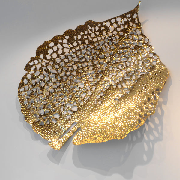Gold Leaf - Shape B - 3D Sculptural Wall Art. Leaf shape wall sculpture. Statement Wall Decoration. Polished Gold Colour. Hammered finish. Materials: Nickel plated Steel. Available in 2 shapes/designs. Top interior design trend. Nature theme home accessories. Multiple Gold Leaves can be installed together to create a striking wall art installation. Large size wall art that will be the focal point in Living Rooms, Dining Rooms, Staircases and Entrance Hallways.