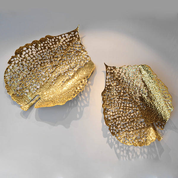 Gold Leaf - Set - 3D Sculptural Wall Art. Leaf shape wall sculpture. Statement Wall Decoration. Polished Gold Colour. Hammered finish. Materials: Nickel plated Steel. Available in 2 shapes/designs. Top interior design trend. Nature theme home accessories. Multiple Gold Leaves can be installed together to create a striking wall art installation. Large size wall art that will be the focal point in Living Rooms, Dining Rooms, Staircases and Entrance Hallways.