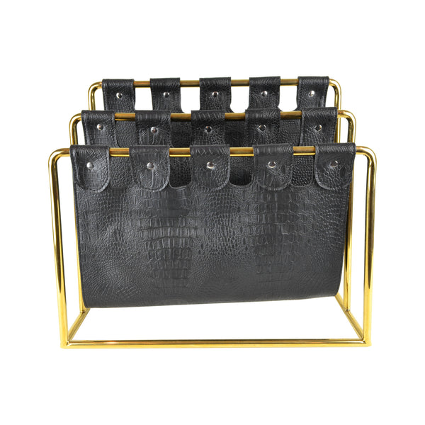 Deco Magazine Holder - Brass View 2 - Magazine caddy. Contemporary Magazine holder with an art deco twist. Faux leather magazine rest. Black and gold colour. Faux crocodile leather detail. Materials: nickel plated steel, faux leather. Dimensions: W45 D20 H39cm. Keep your favourite magazines and books organised in this modern design magazine holder. medium size magazine rest for styling Living rooms, drawing rooms, kitchens and bedrooms.