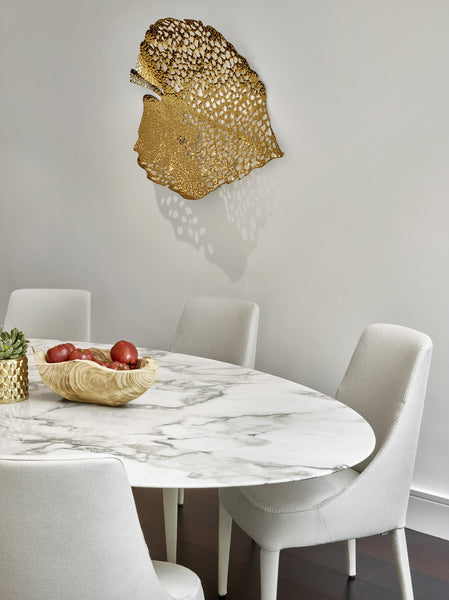 Gold Leaf - Lifestyle 1 - 3D Sculptural Wall Art. Leaf shape wall sculpture. Statement Wall Decoration. Polished Gold Colour. Hammered finish. Materials: Nickel plated Steel. Available in 2 shapes/designs. Top interior design trend. Nature theme home accessories. Multiple Gold Leaves can be installed together to create a striking wall art installation. Large size wall art that will be the focal point in Living Rooms, Dining Rooms, Staircases and Entrance Hallways.