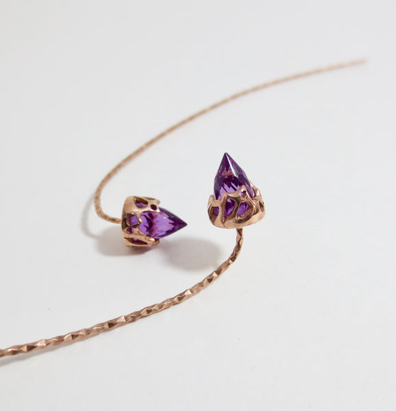 Comet earrings dressed in rose gold with Amethyst.