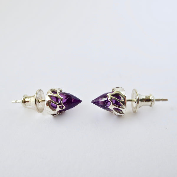 Silver chrysalis studs with Amethyst bullets.
