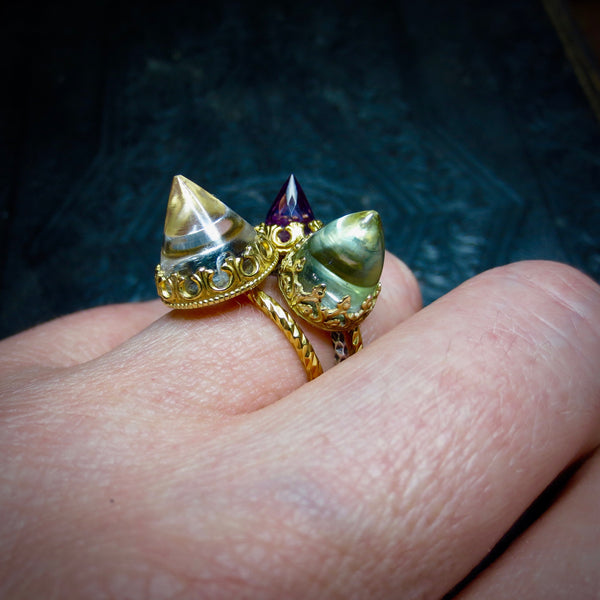Rock crystal temple ring dressed in gold