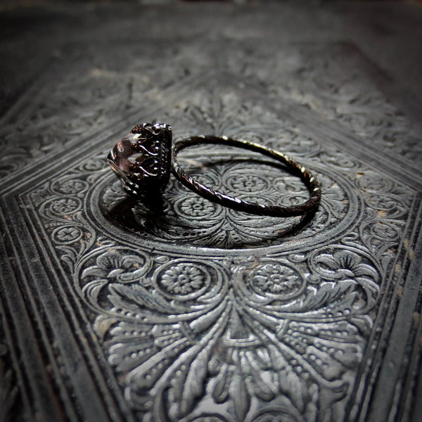 Pyramid rock crystal temple ring dressed in black