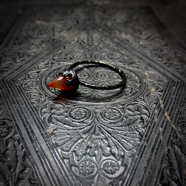 Carnelian temple ring dressed in black