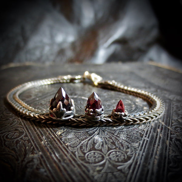 Silver Fish bone chain bracelet with Garnets.