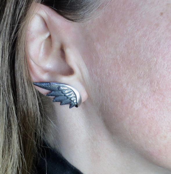 Victory earring in silver