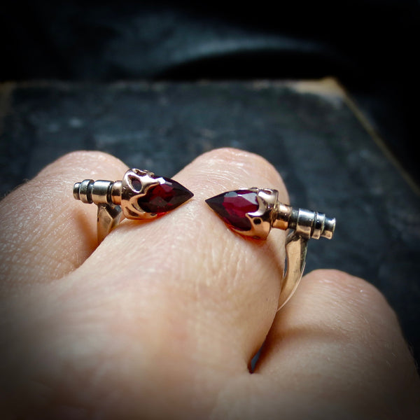 Rose gold and garnet touching tips ring