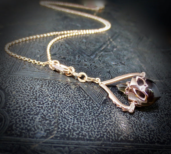 Beastiola pendulum in rose gold, with smokey Quartz.