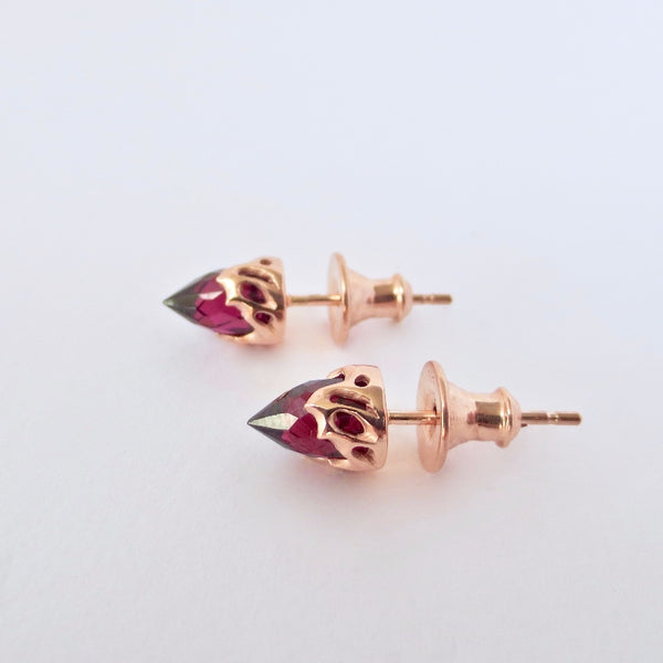 Rose gold chrysalis  studs with burgundy red garnet.