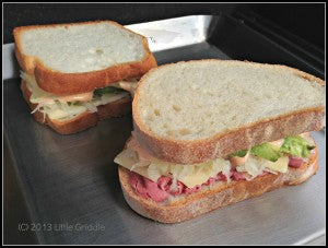 Reuben sandwiches going on the Little Griddle.